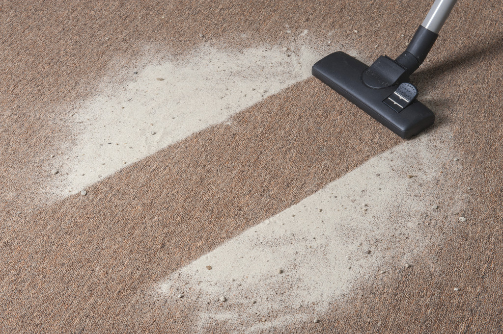 Vacuum cleaning dirt on a carpet
